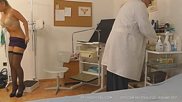Hot female undressing at doctor caught on spy cam