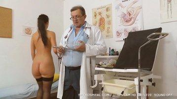 Hidden cam video of hot brunette at gyno doctor