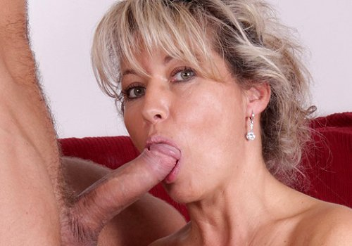 image Sultry senior mom probes her old pussy with a large dildo