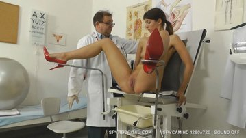 Voyeur doctor video of awesome brunette on gyno chair