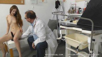 Leggy redhead teen patient gets naked on hidden cam
