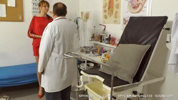 Spy cam clip of redhead girl checked by a gyno doctor